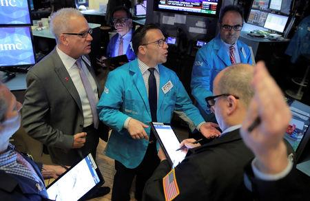 Traders work on the floor at the New York Stock Exchange (NYSE) in New York, U.S., April 18, 2019. REUTERS/Brendan McDermid