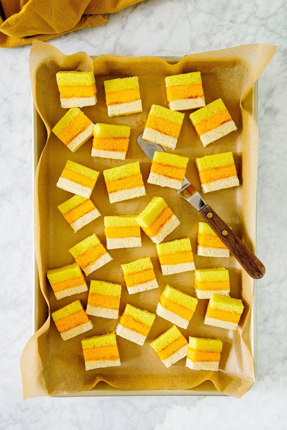 """<p>Here, the classic Italian rainbow cookie gets a Halloween-ified update with layers of orange, yellow, and white almond cake. Jam and chocolate keep things moist and flavorful.</p><p><strong>Get the recipe at <a href=""""https://www.hummingbirdhigh.com/2019/10/candy-corn-cookies.html"""" rel=""""nofollow noopener"""" target=""""_blank"""" data-ylk=""""slk:Hummingbird High"""" class=""""link rapid-noclick-resp"""">Hummingbird High</a>.</strong></p><p><a class=""""link rapid-noclick-resp"""" href=""""https://go.redirectingat.com?id=74968X1596630&url=https%3A%2F%2Fwww.walmart.com%2Fip%2FThe-Pioneer-Woman-Adeline-Cookie-Jar-Turquoise%2F54267223&sref=https%3A%2F%2Fwww.thepioneerwoman.com%2Ffood-cooking%2Fmeals-menus%2Fg32110899%2Fbest-halloween-desserts%2F"""" rel=""""nofollow noopener"""" target=""""_blank"""" data-ylk=""""slk:SHOP COOKIE JARS"""">SHOP COOKIE JARS</a></p>"""