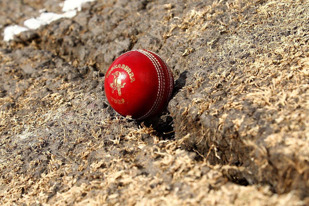 PERTH, AUSTRALIA - DECEMBER 17:  A cricket ball is pictured in a crack on the pitch before the start of play on day five of the Third Ashes Test Match between Australia and England at the WACA on December 17, 2013 in Perth, Australia.  (Photo by Paul Kane/Getty Images)