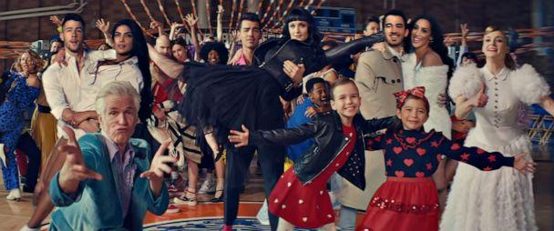 PHOTO: Grab from The Jonas Brothers' latest music video 'What A Man Gotta Do,' their new song that dropped Jan. 17, 2020. Pictured: Nick Jonas, left, with wife Priyanka Chopra Jonas, Joe Jonas with wife Sophie Turner, Kevin Jonas and wife Danielle Jonas. (Music video