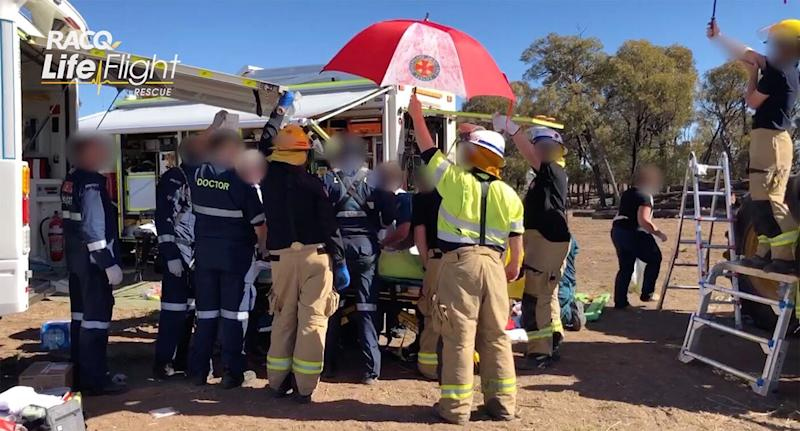 LifeFlight's aeromedical teams, QAS paramedics and local doctors amputate a teenager's leg while he remained trapped in farming machinery. Source: RACQ LifeFlight Rescue
