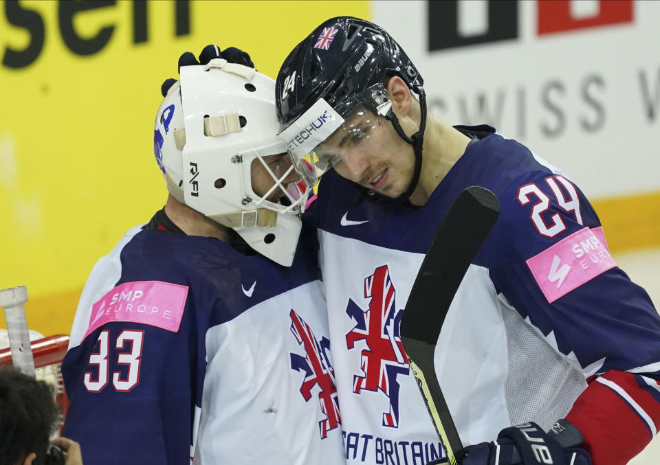 Britain's Ben Bowns, left, and Joshua Tetlow celebrate after the Ice Hockey World Championship group A match between Belarus and Britain at the Olympic Sports Center in Riga, Latvia, Wednesday, May 26, 2021. (AP Photo/Roman Koksarov)