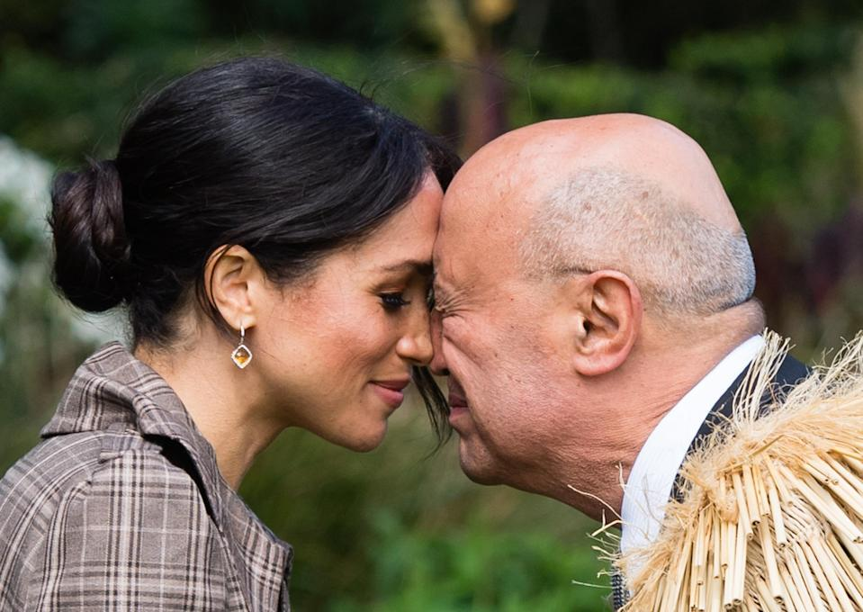 <p>Meghan performs a hongi as she attends a traditional welcome ceremony on the lawns of Goverment House in New Zealand on the royal tour (Getty) </p>