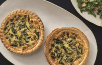"""<p>Snap peas add a sweetness and crunch while the spinach adds some body — welcome changes to the classic creamy textures of quiche. </p> <p><a href=""""https://www.thedailymeal.com/recipes/cheesy-snap-pea-spinach-quiche-recipe?referrer=yahoo&category=beauty_food&include_utm=1&utm_medium=referral&utm_source=yahoo&utm_campaign=feed"""" rel=""""nofollow noopener"""" target=""""_blank"""" data-ylk=""""slk:For the Cheesy Snap Pea & Spinach Quiche recipe, click here."""" class=""""link rapid-noclick-resp"""">For the Cheesy Snap Pea & Spinach Quiche recipe, click here.</a></p>"""