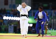 <p>Tina Trstenjak of Slovenia celebrates victory over Clarisse Agbegnenou of France in the Women's -63kg gold medal bout on Day 4 of the Rio 2016 Olympic Games at the Carioca Arena 2 on August 9, 2016 in Rio de Janeiro, Brazil. (Photo by Ryan Pierse/Getty Images) </p>