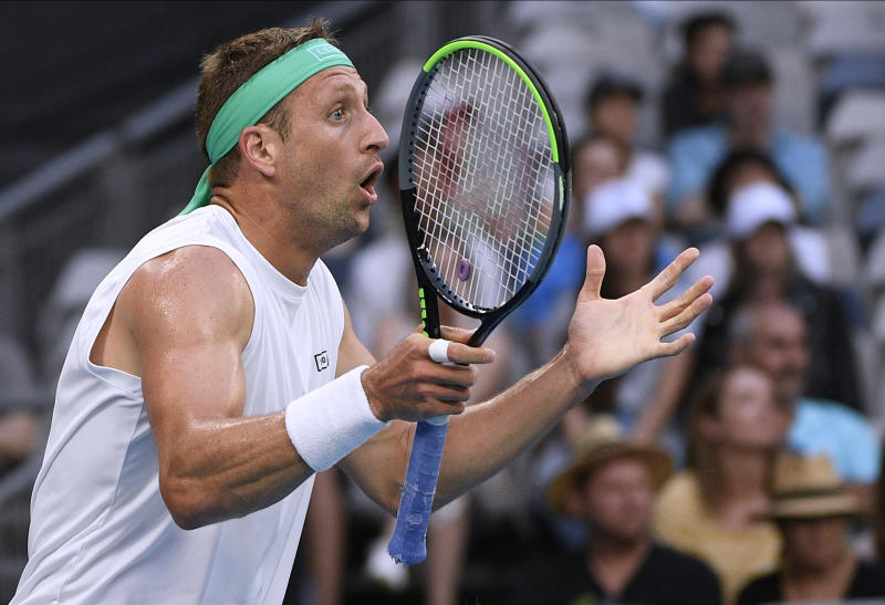 Tennys Sandgren of the U.S. reacts to a line call during his fourth round match against Italy's Fabio Fognini at the Australian Open tennis championship in Melbourne, Australia, Sunday, Jan. 26, 2020. (AP Photo/Andy Brownbill)