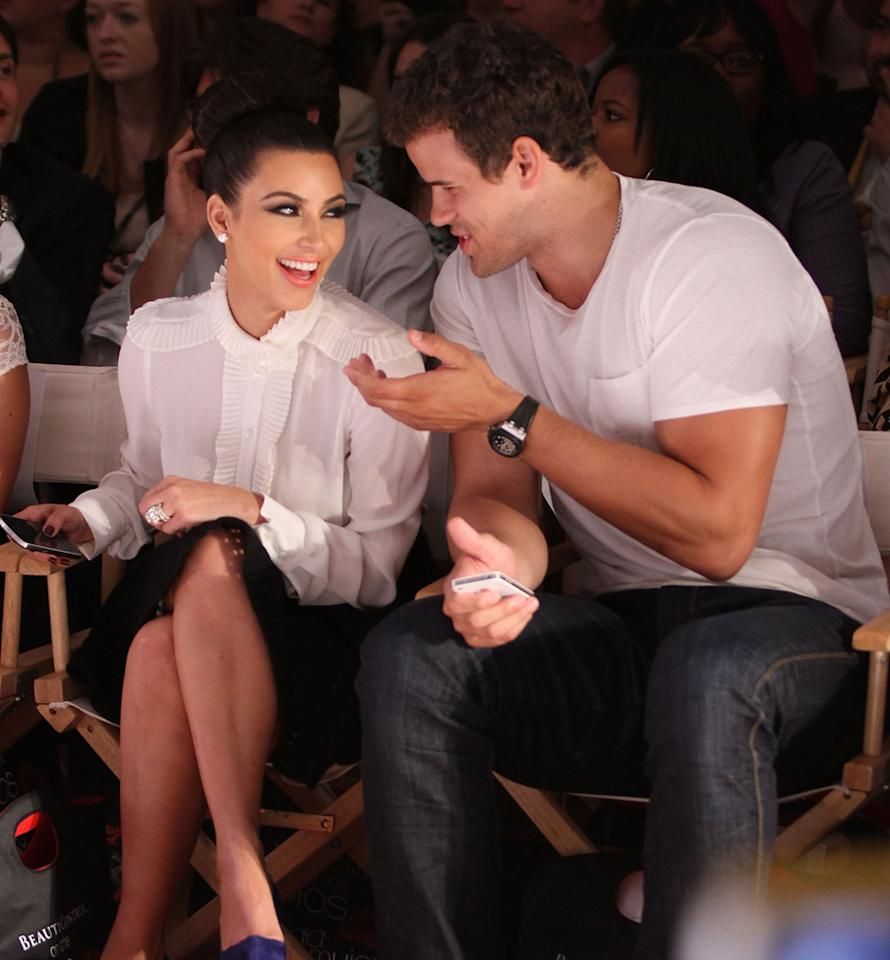 "Kim Kardashian and her new hubby Kris Humphries shared a laugh while supporting her little sis Kylie Jenner as she made her runway debut modeling Avril Lavigne's Abbey Dawn line. Jerritt Clark/<a href=""http://www.gettyimages.com/"" target=""new"">GettyImages.com</a> - September 12, 2011"