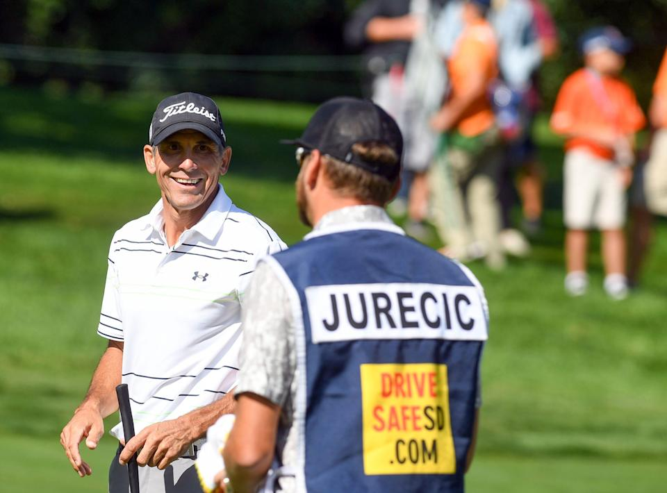 Jay Jurecic smiles at his brother and caddie, Jeff Jurecic, during the first day of the Sanford International golf tournament on Friday, September 17, 2021, at the Minnehaha Country Club in Sioux Falls. Erin Bormett / Argus Leader
