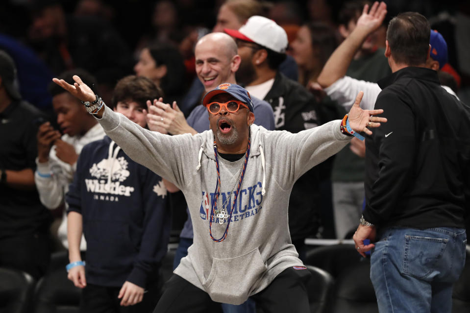 New York Knicks fan and film director Spike Lee reacts from his front-row seat during the second half of an NBA basketball game between the Brooklyn Nets and the Knicks, Friday, Oct. 25, 2019, in New York. (AP Photo/Kathy Willens)