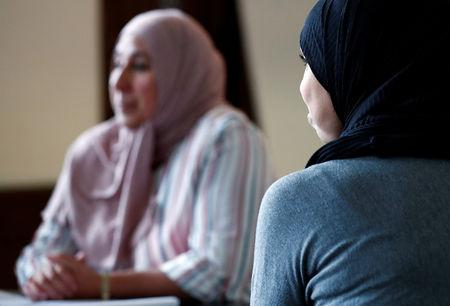 """Belgian mothers attend a meeting of """"Mothers' Jihad"""", a group aiming to repatriate women and children held in Syrian refugee camps, in Antwerp, Belgium September 8, 2018. Picture taken September 8, 2018. REUTERS/Francois Lenoir/File Photo"""