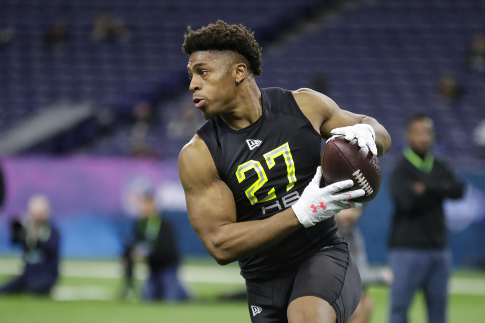 FILE - In this Feb. 28, 2020, file photo, Wisconsin running back Jonathan Taylor runs a drill at the NFL football scouting combine in Indianapolis. Taylor was selected by the Indianapolis Colts in the second round of the NFL football draft Friday, April 24, 2020. (AP Photo/Michael Conroy, File)