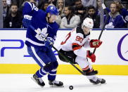 Toronto Maple Leafs defenseman Rasmus Sandin (38) and New Jersey Devils center Jesper Boqvist (90) vie for control of the puck during the third period of an NHL hockey game Tuesday, Jan. 14, 2020, in Toronto. (Frank Gunn/The Canadian Press via AP)