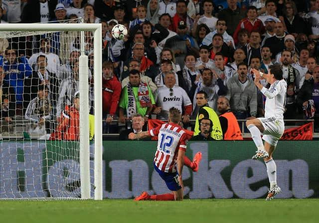 Gareth Bale, right, scores for Real in one of two all-Madrid finals in the 2010s