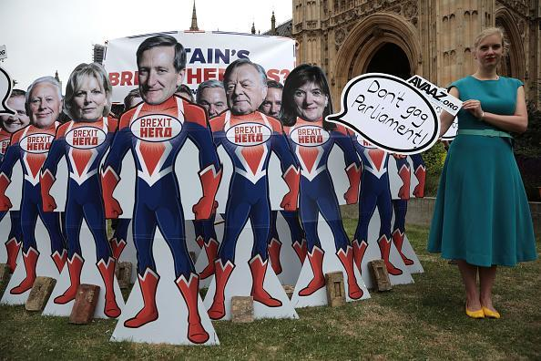 Cardboard cutouts of MPs Tom Tugendhat, Robert Neill, Anna Soubry, Dominic Grieve, Kenneth Clarke, Nicky Morgan, Stephen Hammond and Jeremy Lefroy are presented by pressure group Avaaz as they stage a Brexit vote protest urging the twelve Tory rebels to step up and be 'superheroes' to save the country from Brexit at the House of Commons on June 20, 2018 in London. (Photo by Dan Kitwood/Getty Images)