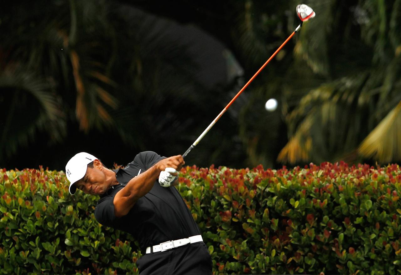 MIAMI, FL - MARCH 08:  Tiger Woods hits his tee shot on the seventh hole during the first round of the 2012 World Golf Championships Cadillac Championship at Doral Golf Resort And Spa on March 8, 2012 in Miami, Florida.  (Photo by Mike Ehrmann/Getty Images)