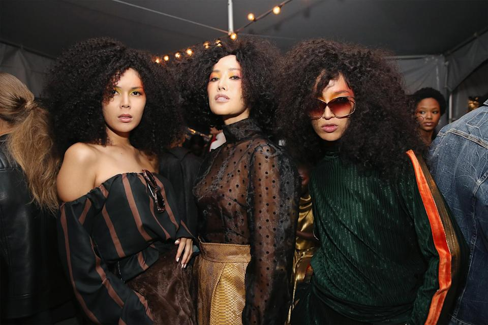 <p>When a trio of curly girls strike a pose, it's epic. (Photo: Getty) </p>