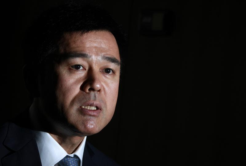 Bank of Japan board member Takehiro Sato speaks during an interview with Reuters at the central bank in Tokyo