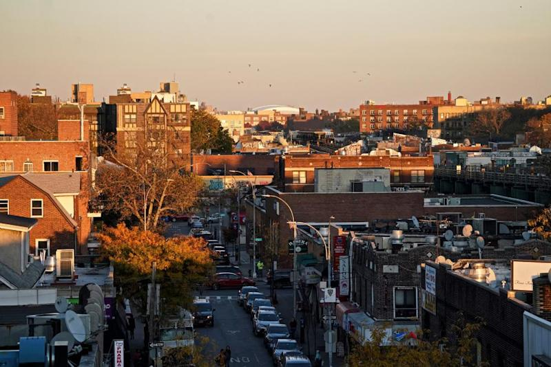 Sunset over Jackson Heights buildings.
