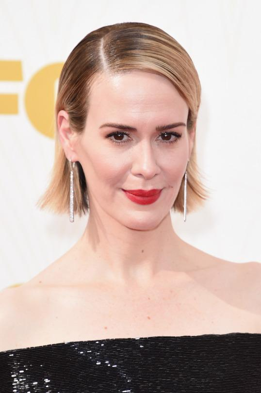 <p>Paulson made her bob extra glam by keeping it sleek with a deep side part. <i>(Photo: Getty Images)</i></p>