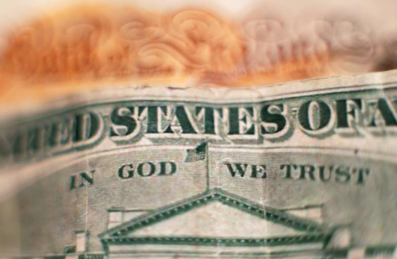 "The design on the reverse of a twenty dollar bill, featuring the official motto of the United States ""In God We Trust"" above a depiction of the White House, placed in front of a ten pound note, in north London. PRESS ASSOCIATION Photo. Picture date: Friday January 27, 2017. Photo credit should read: Yui Mok/PA Wire"