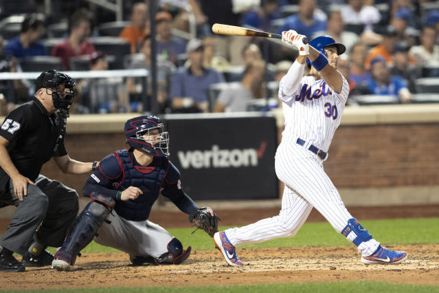 New York Mets' Michael Conforto watches the ball after hitting a home run during the sixth inning of a baseball game against the Cleveland Indians, Tuesday, Aug. 20, 2019, in New York. (AP Photo/Mary Altaffer)