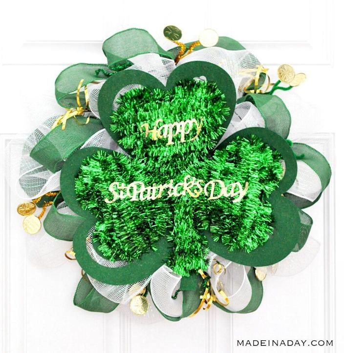 """<p>St. Patrick Day's crafts don't have to be expensive. This project uses pipe cleaners, ribbon, and a door hanger to create a cute wreath for only a few dollars.</p><p><strong>Get the tutorial at <a href=""""https://madeinaday.com/st-patricks-day-dollar-store-mesh-wreath/"""" rel=""""nofollow noopener"""" target=""""_blank"""" data-ylk=""""slk:Made in a Day"""" class=""""link rapid-noclick-resp"""">Made in a Day</a>.</strong><br></p><p><a class=""""link rapid-noclick-resp"""" href=""""https://www.amazon.com/wire-wreath-frames/s?k=wire+wreath+frames&tag=syn-yahoo-20&ascsubtag=%5Bartid%7C2164.g.35012898%5Bsrc%7Cyahoo-us"""" rel=""""nofollow noopener"""" target=""""_blank"""" data-ylk=""""slk:SHOP WIRE WREATH FRAMES"""">SHOP WIRE WREATH FRAMES</a><br></p>"""