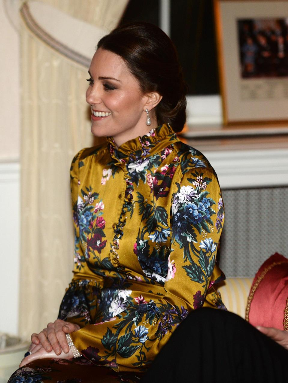<p><strong>The occassion:</strong> A dinner hosted by the British Ambassador in Stockholm.<br><strong>The look:</strong> A mustard and floral print, satin gown by Erdem, costing £1,945.<br>[Photo: Getty] </p>