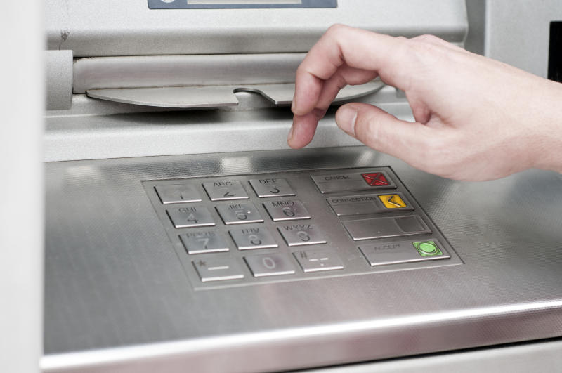 ATM Machine and Mans Hand