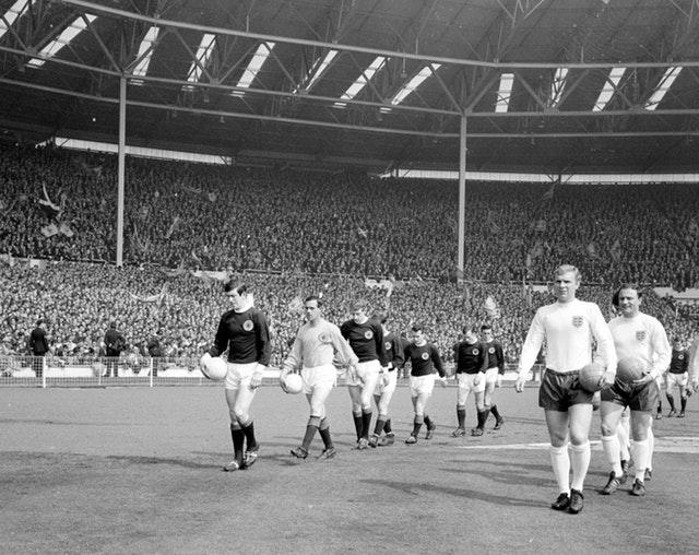 John Greig and Bobby Moore lead out the teams
