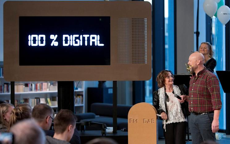 Norwegian radio hosts Berith Olderskog and Geir Schau shut down the northern part of Norway's FM radio network in favor of digital radio at a ceremony in Bodo, Norway January 11, 2017. NTB Scanpix