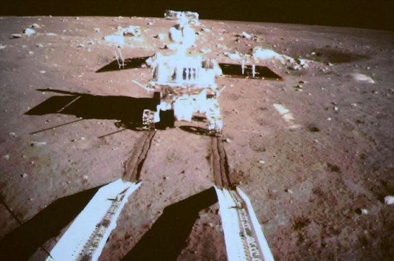 "China's lunar rover Yutu (""Jade Rabbit"") is seen by a camera on the country's Chang'e 3 lander after both successfully landed on the moon together on Dec. 14, 2013. It is China's first lunar rover mission and the first soft-landing on the moon"