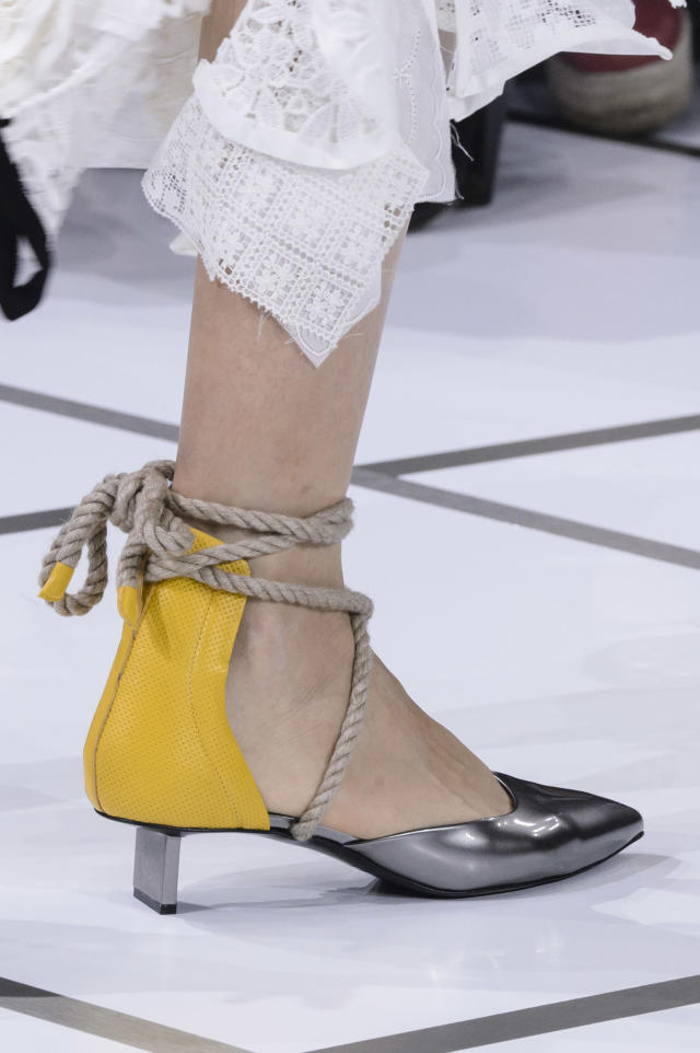 <p><i>Rope tie yellow and silver heels from the SS18 Sacai collection. (Photo: ImaxTree) </i></p>