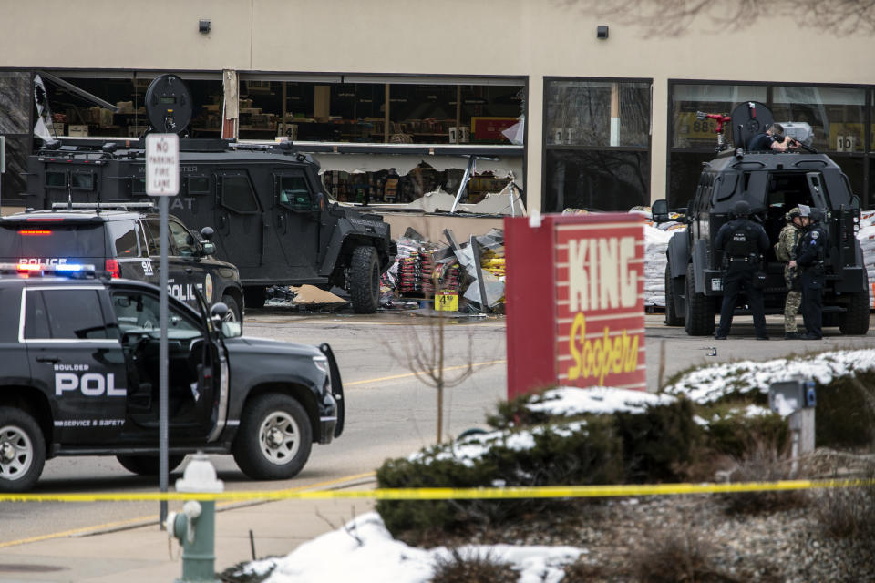 Smashed windows are left at the scene after a gunman opened fire at a King Sooper's grocery store on March 22, 2021 in Boulder, Colorado. (Chet Strange/Getty Images)