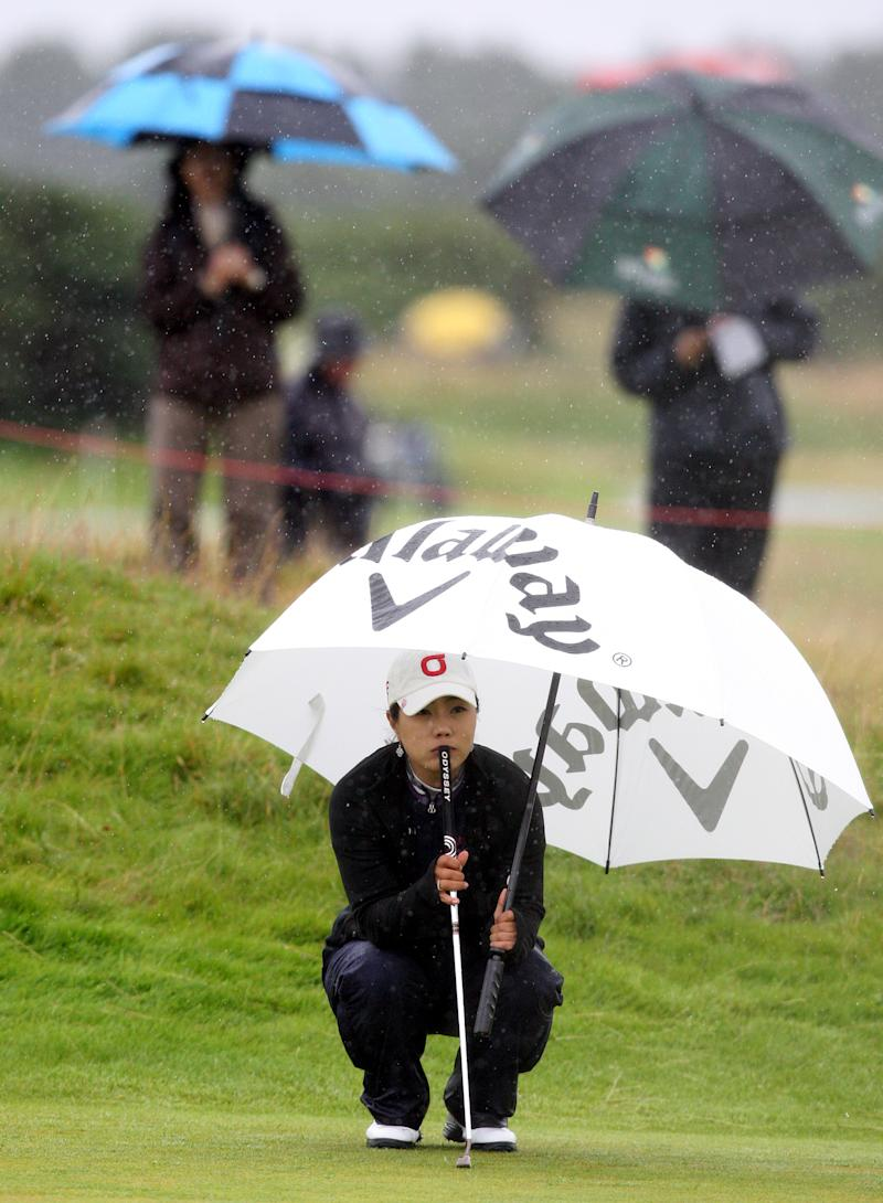 Korea's Meena Lee, lines up  her putt on the sixteenth during the first round of the Women's British Open at Carnoustie Golf Club, Carnoustie, Scotland, Thursday July 28, 2011.(AP Photo/Scott Heppell)