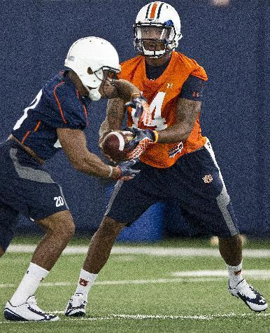 Auburn quarterback Nick Marshall, right, runs drills with running back Corey Grant during NCAA college football practice Friday, Aug. 1, 2014, in Auburn, Ala. (AP Photo/Brynn Anderson)