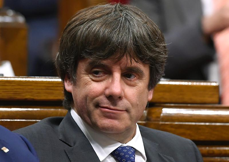 Puigdemont faces arrest for rebellion, sedition and misuse of public funds (AFP Photo/Josep LAGO)