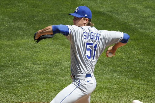 Kansas City Royals starting pitcher Brady Singer throws to the Minnesota Twins in the first inning of a baseball game Sunday, Aug. 16, 2020, in Minneapolis. (AP Photo/Bruce Kluckhohn)