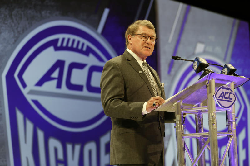 The Latest: Pac-12 Commissioner Larry Scott tests positive