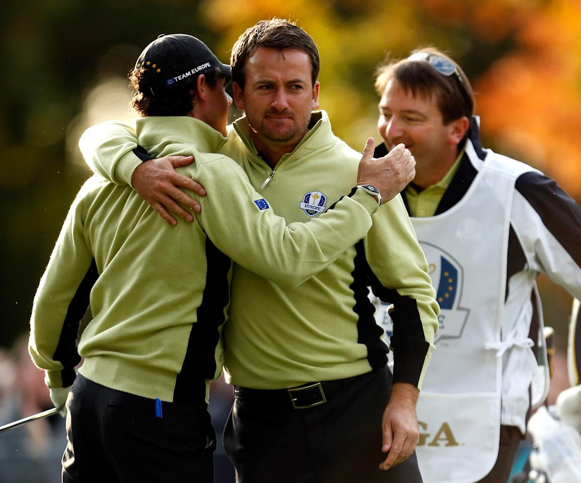 MEDINAH, IL - SEPTEMBER 28:  Rory McIlroy and Graeme McDowell of Europe celebrate on the fourth hole after McIlroy holed a chip shot for birdie during the Morning Foursome Matches for The 39th Ryder Cup at Medinah Country Club on September 28, 2012 in Medinah, Illinois.  (Photo by Jamie Squire/Getty Images)