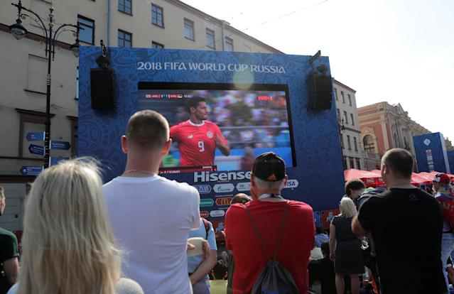 Soccer Football - World Cup - Group E - Costa Rica vs Serbia - Saint Petersburg, Russia - June 17, 2018. Costa Rica's and Serbia's fans watch the broadcast at Saint Petersburg Fan Fest. REUTERS/Henry Romero