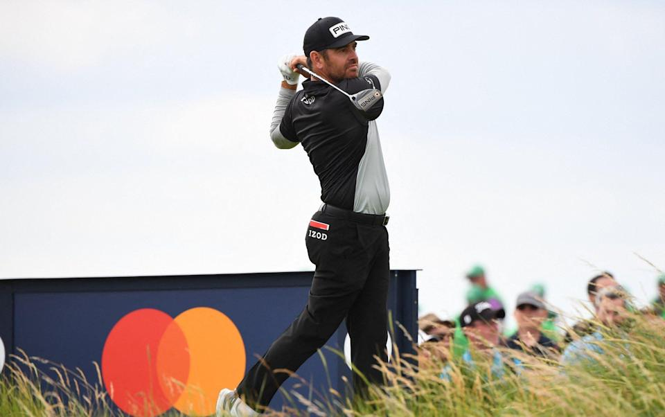 South Africa's Louis Oosthuizen watches his drive from the 9th tee during his first round on day one of The 149th British Open Golf Championship at Royal St George's, Sandwich in south-east England on July 15, 2021. - AFP