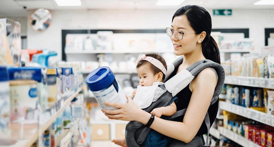 A mother shopping for baby formula