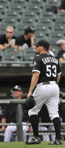 Chicago White Sox starting pitcher Hector Santiago walks to the dugout after being pulled during the third inning of the first game of a doubleheader baseball game against the Cleveland Indians in Chicago, Friday, June 28, 2013. (AP Photo/Paul Beaty)