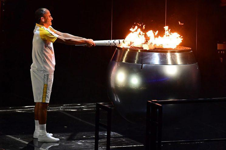 Former Brazilian athlete Vanderlei Cordeiro lights the Olympic cauldron with the Olympic torch during the opening ceremony of the Rio 2016 Olympic Games at Maracana Stadium in Rio de Janeiro on August 5, 2016. / AFP / Emmanuel DUNAND (Photo credit should read EMMANUEL DUNAND/AFP/Getty Images)