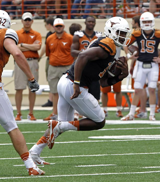 Texas quarterback Tyrone Swoopes (18) runs the ball during the first half of the Orange and White spring NCAA college football game, Saturday, April 19, 2014, in Austin, Texas. (AP Photo/Michael Thomas)