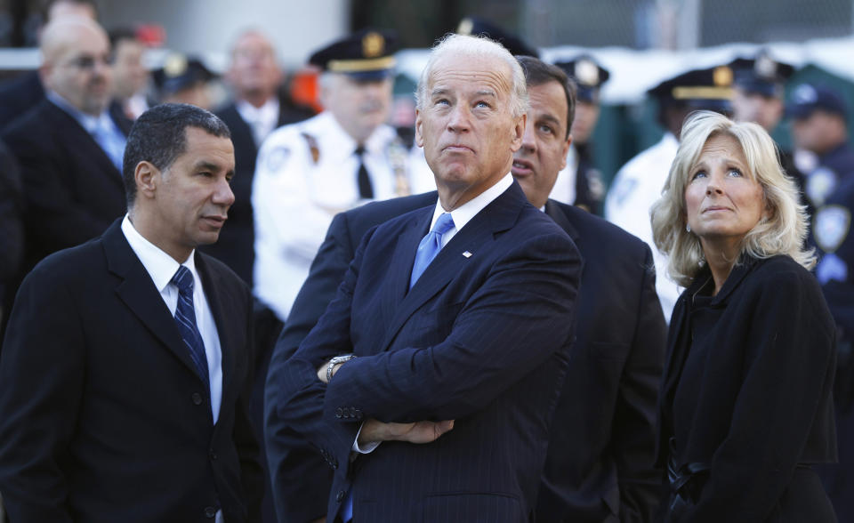 U.S. Vice President Joe Biden (C) and his wife Jill (R) look up at 1 World Trade Center with New York Governor David Paterson (L) and New Jersey Governor Chris Christie at Ground Zero during the ceremony marking the ninth anniversary of the September 11 attacks on the World Trade Center in New York September 11, 2010.  REUTERS/Lucas Jackson (UNITED STATES - Tags: DISASTER ANNIVERSARY POLITICS)