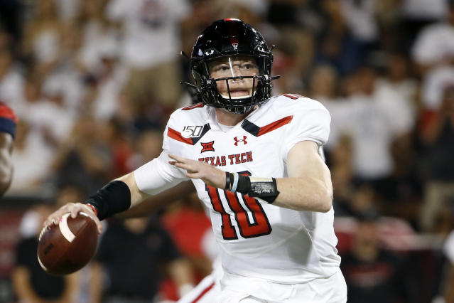 Texas Tech quarterback Alan Bowman (10) looks to pass the ball against Arizona during the second half of an NCAA college football game, Saturday, Sept. 14, 2019, in Tucson, Ariz. Arizona defeated Texas Tech 28-14. (AP Photo/Ralph Freso)
