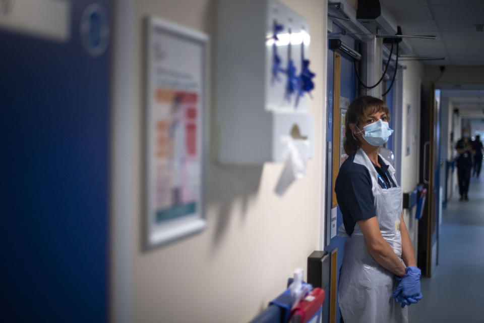 A support worker stands in a corridor as the first patients are admitted to the NHS Seacole Centre at Headley Court, Surrey