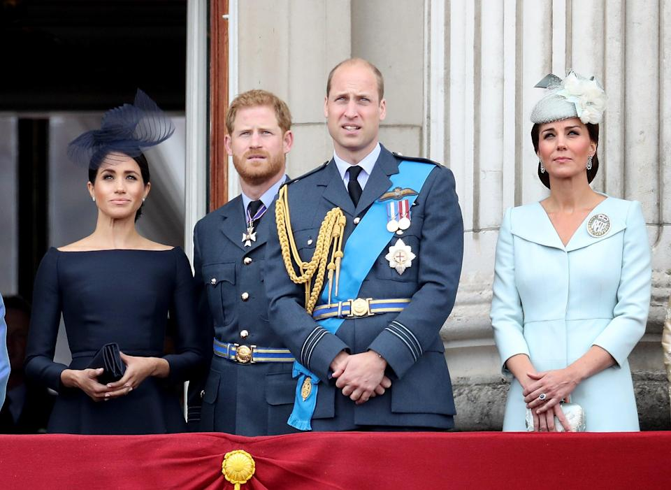 Meghan, Duchess of Sussex, Prince Harry, Duke of Sussex, Prince William, Duke of Cambridge and Catherine, Duchess of Cambridge watch the RAF flypast on the balcony of Buckingham Palace, as members of the Royal Family attend events to mark the centenary of the RAF on July 10, 2018 in London, England.   (Chris Jackson/Getty Images)