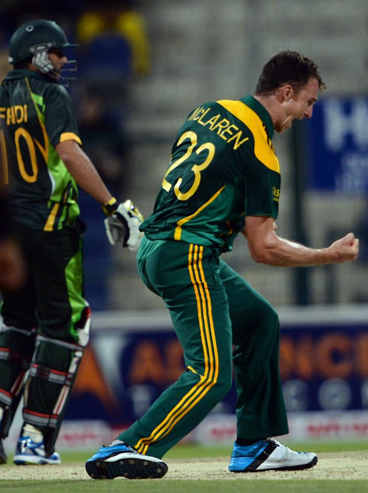 South African bowler Ryan McLaren (R) celebrates after a leg before wicket LBW of Pakistani cricketer Shahid Afridi (L) during the third day-night international in Sheikh Zayed Cricket Stadium in Abu Dhabi on Novemver 6, 2013. South Africa produced a clincal performance to beat Pakistan by 68 runs in the third day-night international and take a 2-1 lead in the five-match series. AFP PHOTO/ Asif HASSAN        (Photo credit should read ASIF HASSAN/AFP/Getty Images)